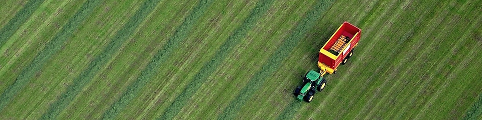 Tractor cutting grass